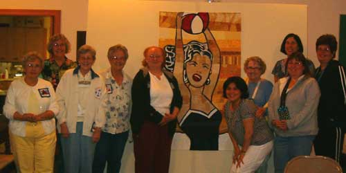 Sixteen South Shore Stitchers guild members contributed 15 slices to Ginny Cooper's  Slice of Art Project.